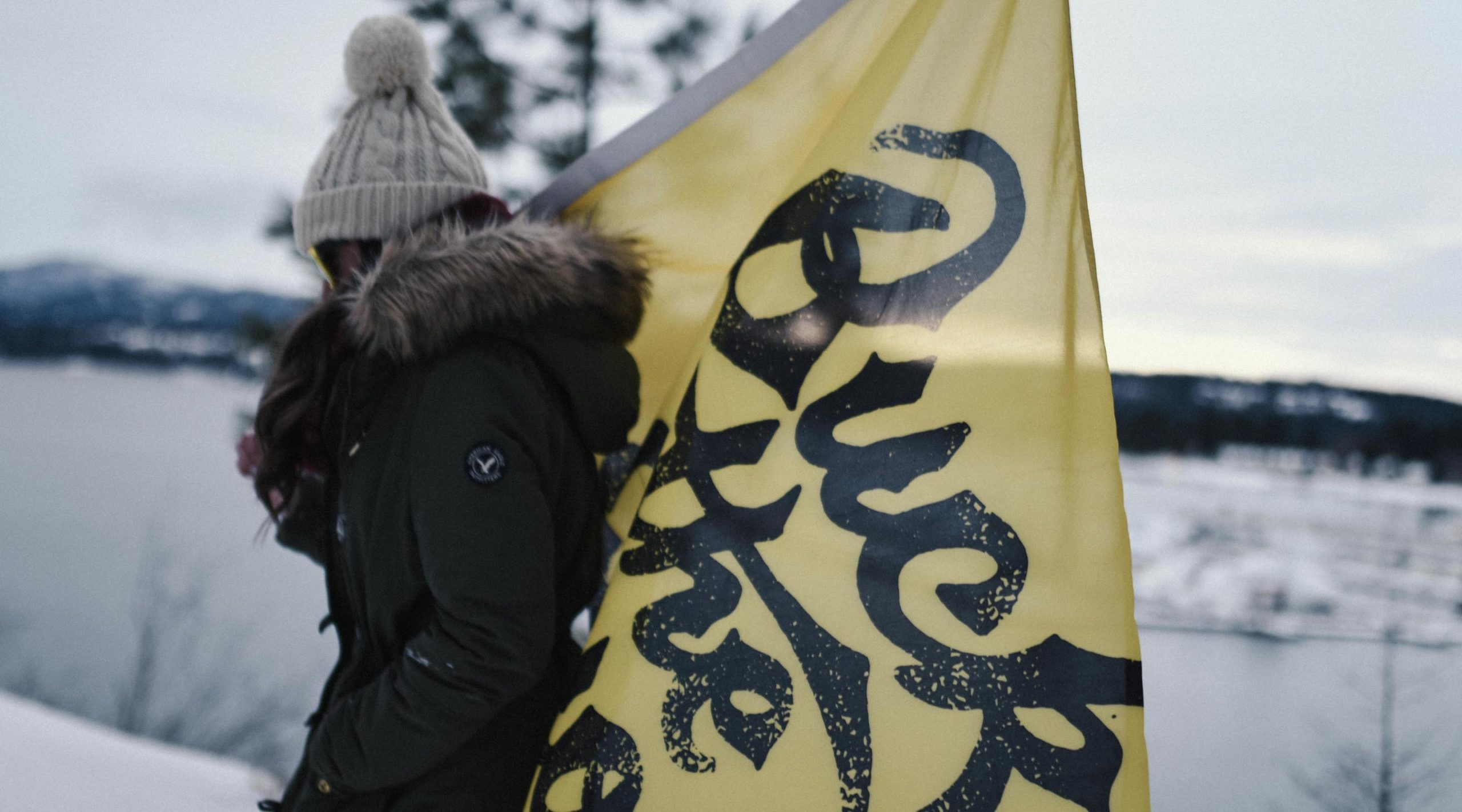 Woman carrying yellow Buck the Quo flag